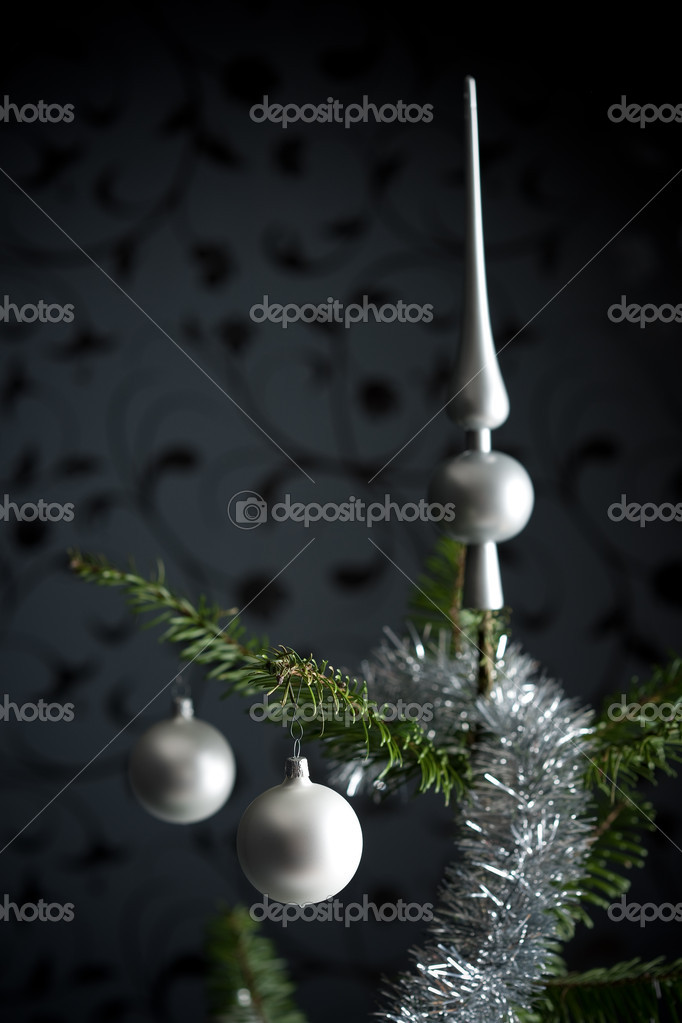 Silver decorated Christmas fir tree with balls and chains, black wallpaper in background  Stock Photo #4696175