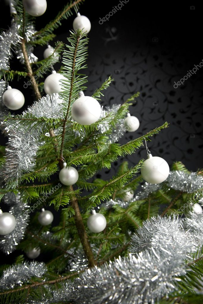 Silver decorated Christmas fir tree with balls and chains, black wallpaper in background — Stock Photo #4696176