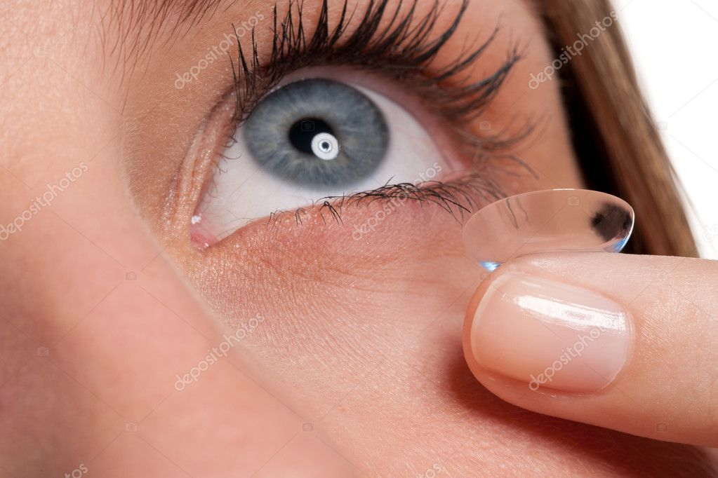 Close-up of blue woman eye with contact lens applying, macro lens — Stock Photo #4696498