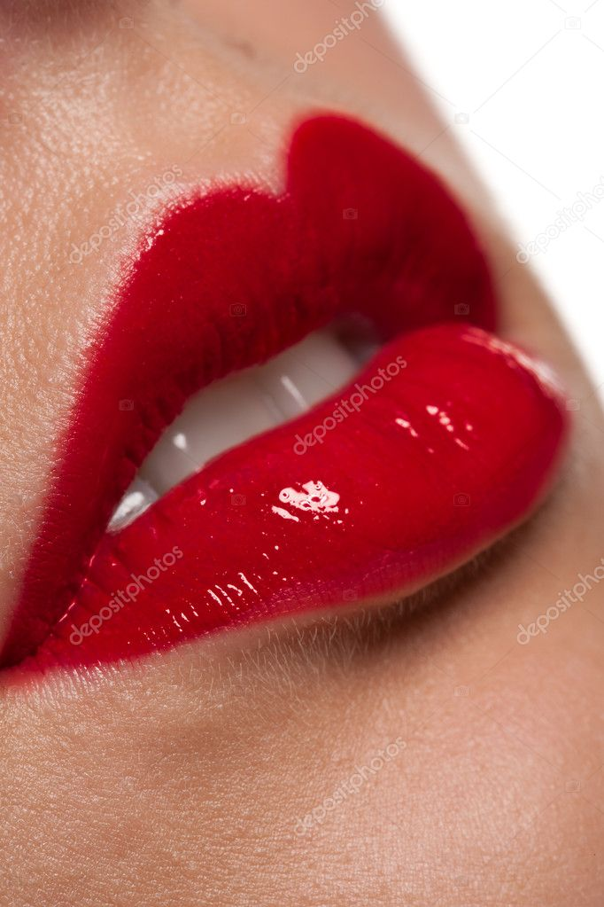 Close-up of gloosy red woman lips, macro lens — Stock Photo #4696509