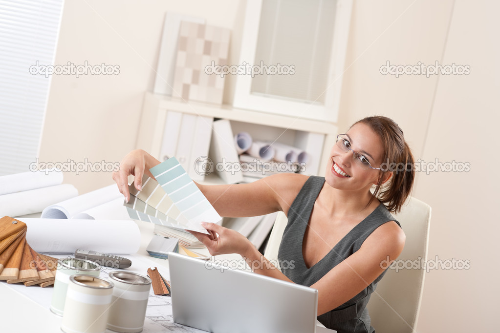 Female Interior Designer Working At Office Stock Photo