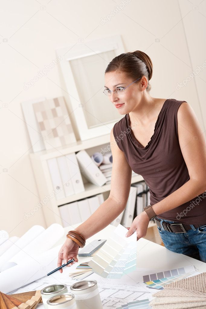 Young female designer working at office with color swatches — Stock Photo #4698508