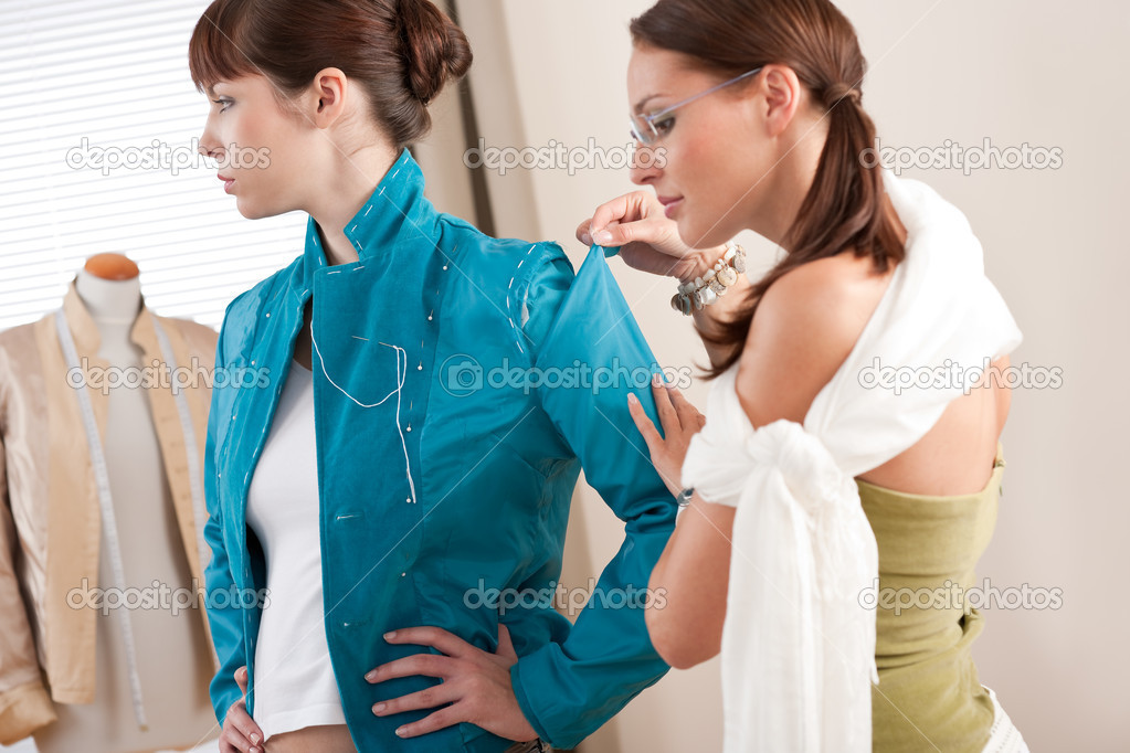 Model fitting by professional female fashion designer studio — Stock Photo #4698658