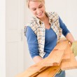 Home improvement - handywoman carry wooden plank — Stock Photo #4946820