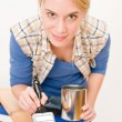 Home improvement - handywoman painting wooden plank — Stock Photo