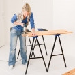 Home improvement - handywoman cutting wooden floor — Stock Photo #4946831