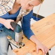 Home improvement - handywoman cutting wooden floor — Stock Photo #4946836