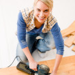 Stock Photo: Home improvement - handywomsanding wooden floor