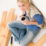 Home improvement - handywoman coffee break — Stock Photo #4946864