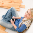 Home improvement - handywoman coffee break — Stock Photo #4946873