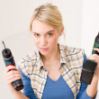 Home improvement - woman with battery screwdriver — Stock Photo