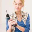 Home improvement - woman with battery screwdriver — Stock Photo #4946887