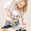 Home improvement - handywoman cutting tile — Stock Photo #4946898