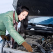 Winter car breakdown - woman repair motor — Zdjęcie stockowe