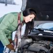 Winter car breakdown - woman repair motor — Stock Photo