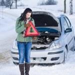Winter car breakdown - woman warning triangle — Stock Photo