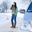 Stock Photo: Winter car breakdown - womcall for help