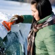 Winter car - woman remove snow from windshield — Stok fotoğraf