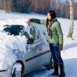 Winter car - woman remove snow from windshield — Stock Photo #4947074