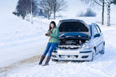Winter car breakdown - woman call for help — Stok fotoğraf