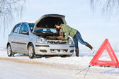 Winter car breakdown - woman repair motor — ストック写真