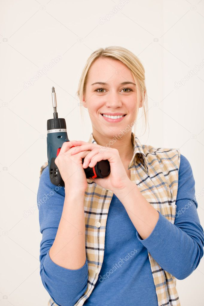 Home improvement - woman with battery cordless screwdriver — Stock Photo #4946877