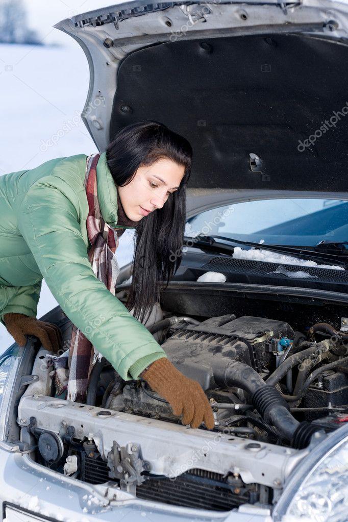Winter car breakdown woman repair motor stock photo for Motor vehicle repair license