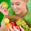 Healthy lifestyle - woman with fruit shopping paper bag — Стоковая фотография