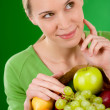 Healthy lifestyle - thoughtful woman with fruit shopping paper b — Stock Photo