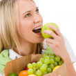Healthy lifestyle - woman with fruit shopping paper bag — Stock Photo