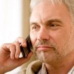 Thoughtful senior mature man call on mobile phone — Stock Photo