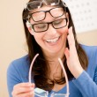 Stock Photo: Opticiclient choose prescription glasses