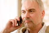 Thoughtful senior mature man call on mobile phone — ストック写真