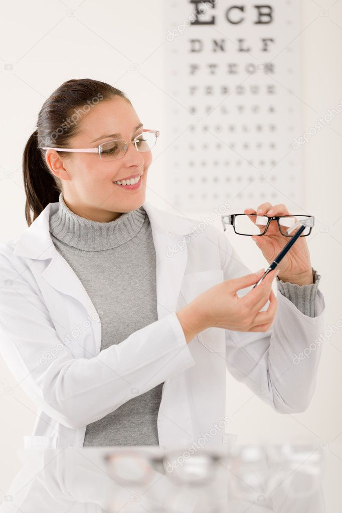 Optician Doctor Woman With Glasses And Eye Chart Stock