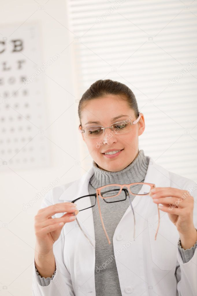 Optician doctor woman with prescription glasses and eye chart  Stock Photo #5011366