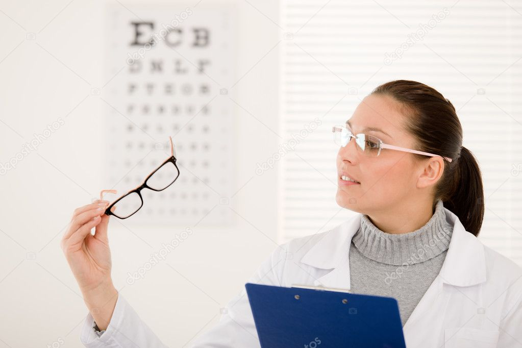 Optician doctor woman with prescription glasses and eye chart  Stock Photo #5011372