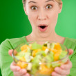 Healthy lifestyle - woman holding fruit salad bowl — Stock Photo