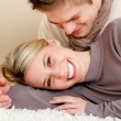 Couple in love - happy relax at home - Stock Photo