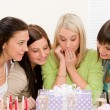 Birthday party - surprised woman getting present — Stock Photo #5193326
