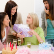 Stock Photo: Birthday party - womgetting present with champagne