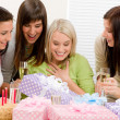 Birthday party - happy woman getting present - Stockfoto