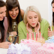 Birthday party - woman blowing candle on cake — Stock Photo #5193338