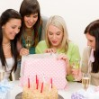 Birthday party - woman unwrap present, celebrating — Stock Photo