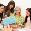 Stock Photo: Birthday party - woman unwrap present, celebrating