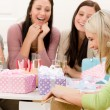 Stock Photo: Birthday party - womunwrap present, celebrating