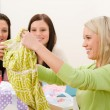 Birthday party - woman unwrap present, surprise - Stock Photo