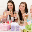 Birthday party - woman drink champagne - Stock Photo