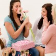 Stock Photo: Birthday party - woman getting present and flower