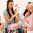 Birthday party - woman getting present and flower — Stock Photo #5193416