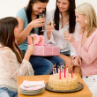 Birthday party - woman getting present and flower — Stock Photo